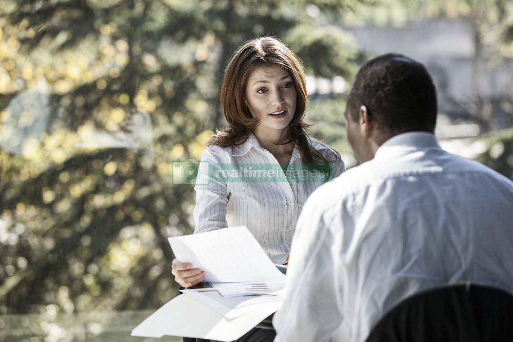 October 5, 2010 - Caucasian business woman discussing paperwork in a meeting. (Credit Image: © Mint Images via ZUMA Wire)