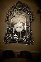 Venetian glass mirror reflecting a chandelier at Tavern on the Green. .(Photo by Robert Caplin)...