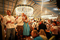 A couple enjoying Oktoberfest in the Ochsenbraterei (Spatenbräu-Festhalle)tent in Munich, Germany