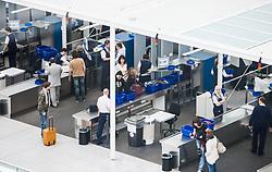 THEMENBILD - Airport Muenchen, Franz Josef Strauß (IATA: MUC, ICAO: EDDM), Der Flughafen Muenchen zählt zu den groessten Drehkreuzen Europas, rund 100 Fluggesellschaften verbinden ihn mit 230 Zielen in 70 Laendern, im Bild Passagiere bei der Sicherheitskontrolle // THEME IMAGE, FEATURE - Airport Munich, Franz Josef Strauss (IATA: MUC, ICAO: EDDM), The airport Munich is one of the largest hubs in Europe, approximately 100 airlines connect it to 230 destinations in 70 countries. picture shows: Passengers at the security checkpoint, Munich, Germany on 2012/05/06. EXPA Pictures © 2012, PhotoCredit: EXPA/ Juergen Feichter