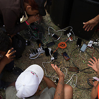 People on the migrant caravan charged their mobile phones at Juchitán, Oaxaca