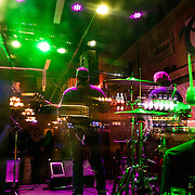 A band is seen through a window as they perform in a bar on Music Row in downtown Nashville, Tennessee on Friday, November 13, 2015. (Alex Menendez via AP)
