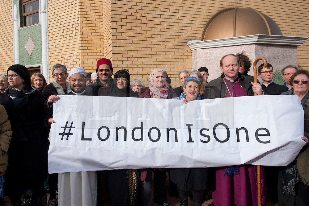 """© Licensed to London News Pictures. 03/02/2017. London, UK. A human circle of solidarity forms outside Wightman Road mosque in north London during Friday prayers in an event backed by a coalition of faith groups, including members of Reform Judaism, the Christian Muslim Forum and Faiths Forum for London.  The aim is to """"stand with our Muslim brothers and sisters at this time of international turbulence"""", say the organisers. Photo credit : Stephen Chung/LNP"""