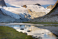 Glaciated Peaks of Boulder/Salal Divide reflected in waters of Salal Creek near Athelney Pass, Coast Range, British Columbia, Canada