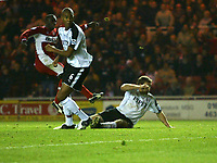Photo: Andrew Unwin.<br /> Middlesbrough v Fulham. The Barclays Premiership.<br /> 20/11/2005.<br /> Middlesbrough's Jimmy Floyd Hasselbaink (L) fires home his team's third goal, putting them into the lead.
