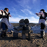 """Northwest Territories, known as Nunuvat, Canada. Inuit women in traditional """"Amautiq"""" near Sila river, Wager Bay."""