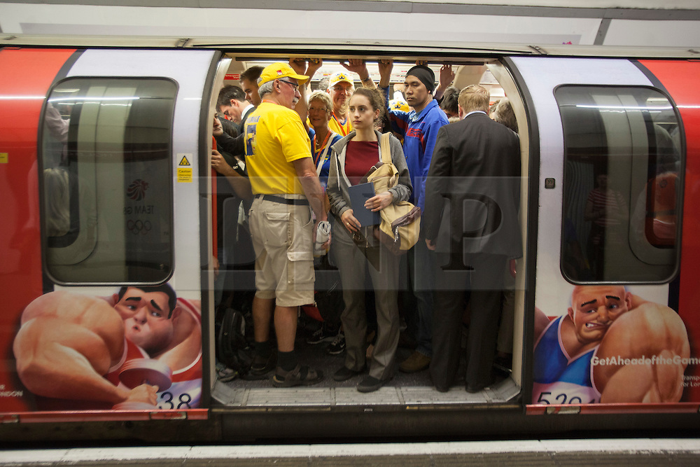 © licensed to London News Pictures. London, UK 03/08/2012. Tube passengers waiting on packed Central line trains as the line was partly suspended and lost its connection to Stratford due to a signal failure at Bethnal Green on 03/07/12, one of the busiest days of the Games. Photo credit: Tolga Akmen/LNP