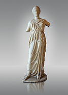 Marble statue of Athena, the Goddess of Wisdom, Skills & Warfare from Leptis Magna, Tripolitana. Roman copy of Greek 5th cent. B.C statue. Istanbul Archaeological Museum, Turkey. Inv. No 435T Cat. Mendel 532. .<br /> <br /> If you prefer to buy from our ALAMY STOCK LIBRARY page at https://www.alamy.com/portfolio/paul-williams-funkystock/greco-roman-sculptures.html- Type -    Istanbul    - into LOWER SEARCH WITHIN GALLERY box - Refine search by adding a subject, place, background colour, museum etc.<br /> <br /> Visit our CLASSICAL WORLD HISTORIC SITES PHOTO COLLECTIONS for more photos to download or buy as wall art prints https://funkystock.photoshelter.com/gallery-collection/The-Romans-Art-Artefacts-Antiquities-Historic-Sites-Pictures-Images/C0000r2uLJJo9_s0c