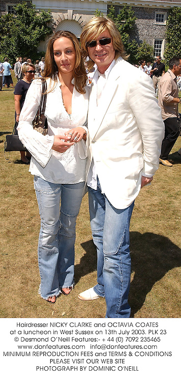 Hairdresser NICKY CLARKE and OCTAVIA COATES at a luncheon in West Sussex on 13th July 2003.PLK 23