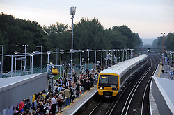 © under license to London News Pictures. 02/01/14. An average 2.8% increase in rail fares comes into effect on Thursday 2nd Jan 2014, pushing the cost of some commuter travel to more than £5,000 a year. FILE PICTURE DATED: 06/09/2013<br /> A grey and overcase start to the day for London commuters this morning (06.09.2013). Armed with their umbrellas commuters at Pettswood train station in Greater London near Bromley looked to be missing the sun already.<br /> Photo credit :Grant Falvey/LNP