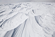 Wind swept snow crust on a high ridge below Pawnee Peak, Indian Peaks Wilderness, Rocky Mountains, Colorado.