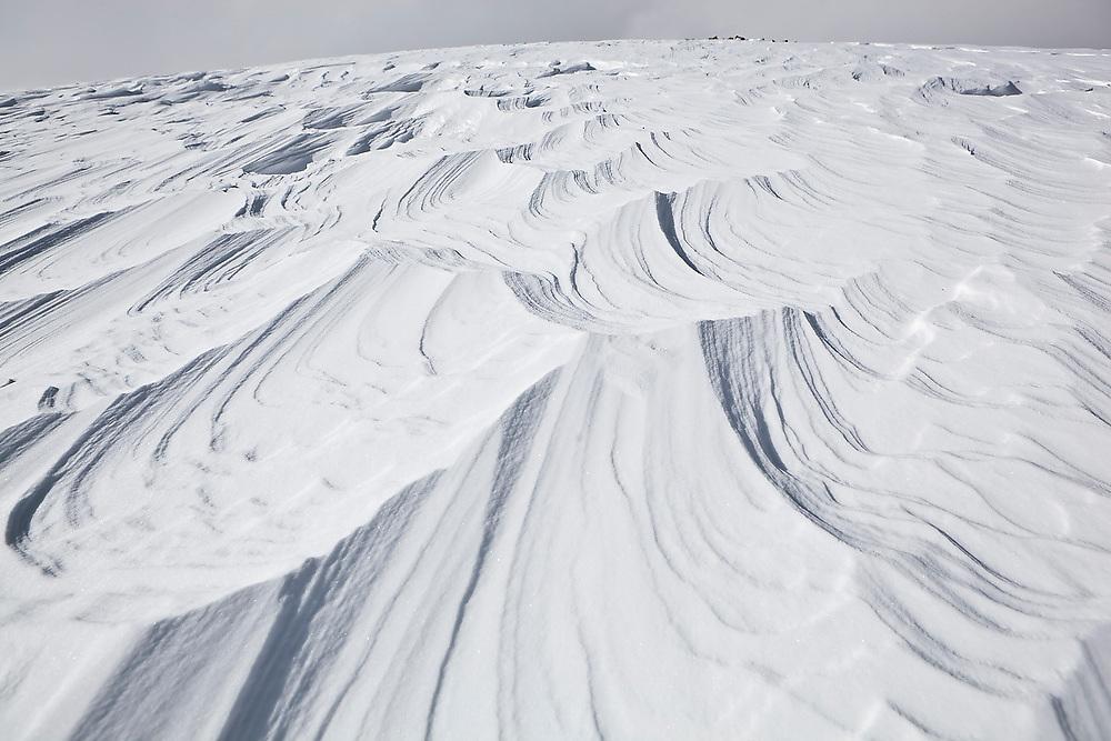 Wind swept snow crust on a high ridge below Pawnee Peak, Indian Peaks Wilderness, Rocky Mountains, Colorado.