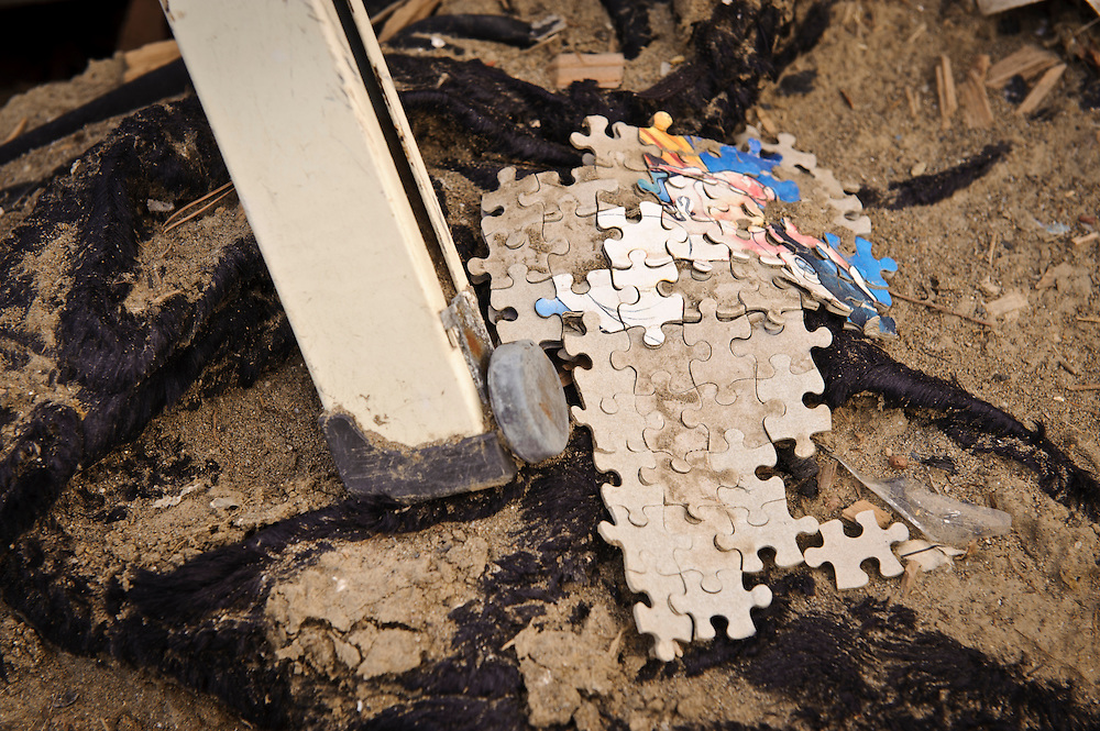 A jigsaw puzzle amongst debris from the March 11 tsunami, Ishinomaki, Miyagi Prefecture, Japan, May 5, 2011. Almost two months after the devastating earthquake and tsunami the reconstruction has barely begun.