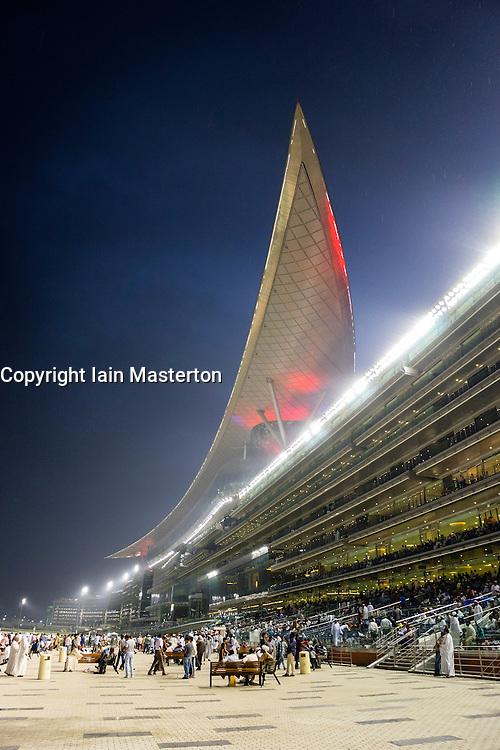 Horseracing meeting at Al Meydan racecourse at night in Dubai United Arab Emirates