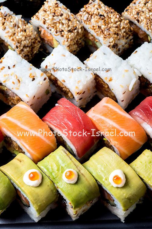 Assortment of Sushi including: Sushi Maki, futo maki, and Insideout