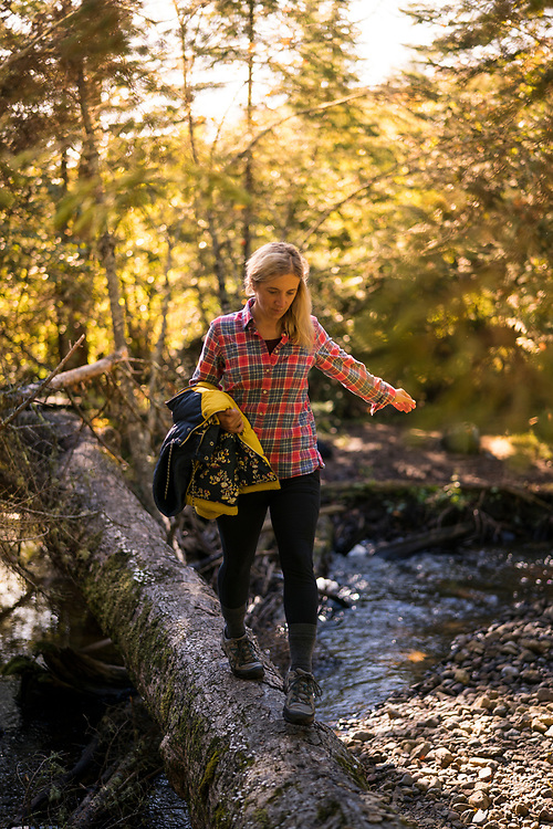 Hiking in fall along the Mosquito Falls trail of Pictured Rocks National Lakeshore Michigan's Upper Peninsula.