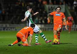 Yeovil Town's John Lundstram is tackled by Blackpool's Dan Gosling - Photo mandatory by-line: Dougie Allward/JMP - Tel: Mobile: 07966 386802 03/12/2013 - SPORT - Football - Yeovil - Huish Park - Yeovil Town v Blackpool - Sky Bet Championship