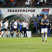 Fenerbahce's Dirk Kuyt (2ndR) during their Turkish SuperLeague Derby match Trabzonspor between Fenerbahce at the Avni Aker Stadium at Trabzon Turkey on Sunday, 14 September 2014. Photo by Aykut AKICI/TURKPIX