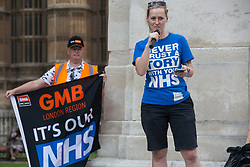 Occupational therapist Jordan Rivera addresses NHS workers from the grassroots NHSPay15 campaign outside Parliament before a march to 10 Downing Street to present a petition signed by over 800,000 people calling for a 15% pay rise for NHS workers on 20th July 2021 in London, United Kingdom. At the time of presentation of the petition, the government was believed to be preparing to offer NHS workers a 3% pay rise in 'recognition of the unique impact of the pandemic on the NHS'.