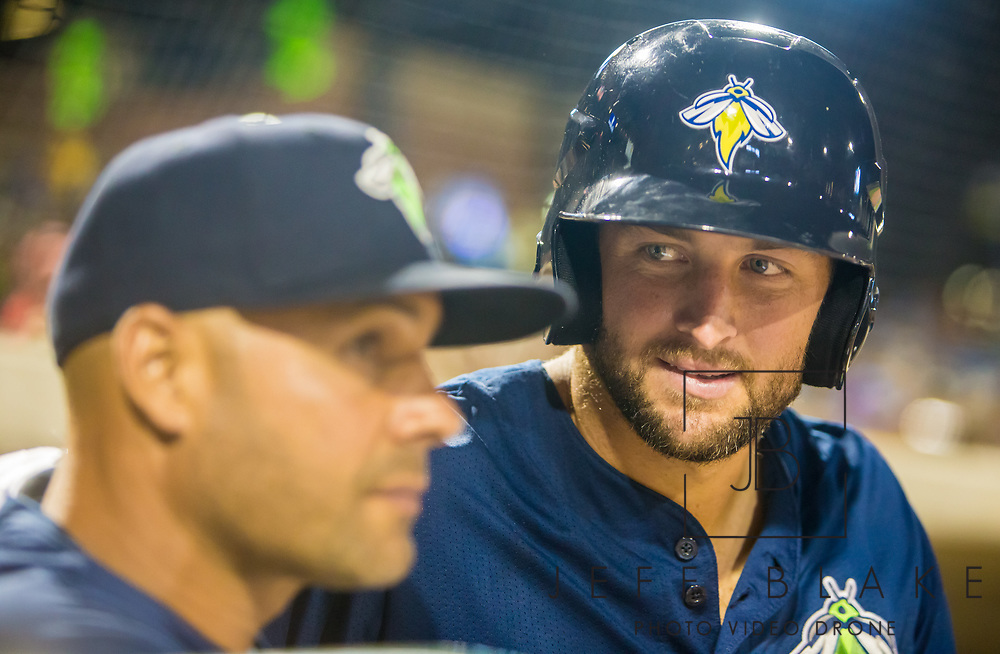 Columbia Fireflies left fielder Tim Tebow speaks with hitting coach Joel Fuentes during a game at Spirit Communications Park on April 21, 2017. Photo by Jeff Blake/Jeff Blake Photography