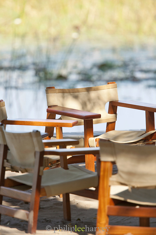 Chairs around a camp fire in the early evening, in the Okavango Delta, Botswana