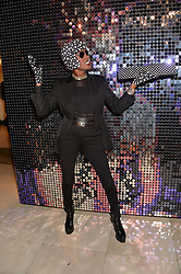 GRACE JONES at a private view of Isabella Blow: Fashion Galore! held at Somerset House, London on 19th November 2013.
