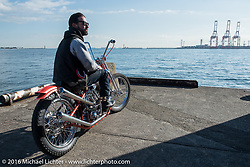 "Max Schaaf with his ""Friend of the Devil"" 4Q Conditioning Harley-Davidson Panhead at the Yokohama docks where invited custom builder's bikes from the USA were unloaded prior to the Mooneyes Yokohama Hot Rod & Custom Show. Yokohama, Japan. December 3, 2016.  Photography ©2016 Michael Lichter."
