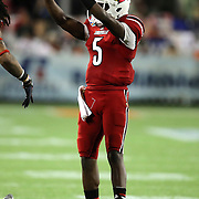Louisville Cardinals quarterback Teddy Bridgewater (5) celebrates a touchdown run during the NCAA Football Russell Athletic Bowl football game between the Louisville Cardinals and the Miami Hurricanes, at the Florida Citrus Bowl on Saturday, December 28, 2013 in Orlando, Florida. Louisville won the game by a score of 36-9. (AP Photo/Alex Menendez)