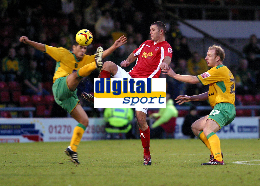 Photo: Dave Linney.<br />Crewe Alexandra v Norwich City. Coca Cola Championship.<br />10/12/2005.High kicking action @ Gresty Rd with Adam Drury(Norwich/left)   Michael Higdon(Crewe/Centre) & Gary Docherty(Norwich/right)