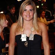 NLD/Utrecht/20070928 - Premiere film Goud over Nederlands dames hockeyelftal, Kim Lammers met ketting van gouden medailles