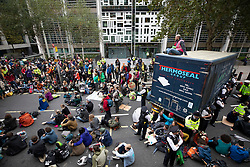 © Licensed to London News Pictures. 07/10/2019. London, UK. Extinction Rebellion activists blockade Marsham Street with a lorry outside the Home Office in central London. Activists are converging on Westminster blockading roads in the area for at least two weeks calling on government departments to 'Tell the Truth' about what they are doing to tackle the Emergency. Photo credit: Peter Macdiarmid/LNP