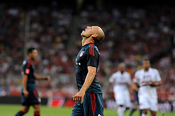 31.07.2013, Allianz Arena, Muenchen, Audi Cup 2013, FC Bayern Muenchen vs Sao Paulo, im Bild, Arjen ROBBEN (FC Bayern Muenchen) frustriert. Einzelbild, angeschnitten, angeschnittenes einzelmotiv, halbfigur, halbe Figur, hochformat, vertikal, Aktion,  // during the Audi Cup 2013 match between FC Bayern Muenchen and Sao Paulon at the Allianz Arena, Munich, Germany on 2013/07/31. EXPA Pictures © 2013, PhotoCredit: EXPA/ Eibner/ Wolfgang Stuetzle<br /> <br /> ***** ATTENTION - OUT OF GER *****
