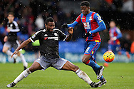 John Obi Mikel of Chelsea challenges Wilfried Zaha of Crystal Palace. Barclays Premier League match, Crystal Palace v Chelsea at Selhurst Park in London on Sunday 3rd Jan 2016. pic by John Patrick Fletcher, Andrew Orchard sports photography.