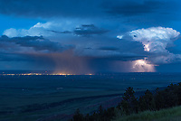 When I reached this overlook in the Bighorn Mountains, one thunderstorm was moving off to the east, while another approached from the north. This is the eastern storm, dumping rain over the lights of Sheridan.