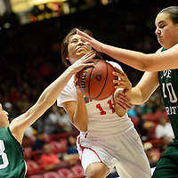 031314  Adron Gardner/Independent<br /> <br /> Shiprock Chieftain Lacey Howe (11) comes under pressure from Hope Christian Huskies Christine Heisey (23), left,  and  Shelby Perry (40) during the state high school basketball tournament at The Pit in Albuquerque Thursday.