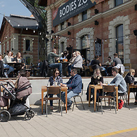 People are seen at restaurant terraces as they reopen during the ease after the COVID-19 pandemic restrictions in Budapest, Hungary on April 24, 2021. ATTILA VOLGYI