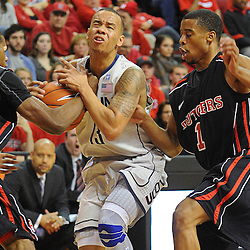Rutgers Scarlet Knights guard/forward Mike Poole (10) strips the ball from Connecticut Huskies guard Shabazz Napier (13) during Rutgers' 67-60 upset victory over #8 UConn in NCAA Big East Basketball action at the Louis Brown Athletic Center in Piscataway, N.J. on Jan 7, 2012.
