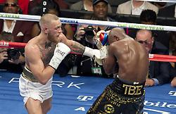August 26, 2017 - Las Vegas, NEVADA, USA - Floyd Mayweather Jr., (Black and Gold shorts), fights Conor McGregor (White Shorts)in a super welterweight boxing match Saturday, Aug. 26, 2017, in Las Vegas. (Credit Image: © Armando Arorizo/Prensa Internacional via ZUMA Wire)
