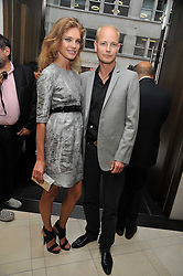 Natalia Vodianova and her husband the HON.JUSTIN PORTMAN at a reception hosted by Vogue and Burberry to celebrate the launch of Fashions Night Out - held at Burberry, 21-23 Bond Street, London on 10th September 2009.