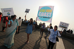 March 30, 2019 - Mumbai, India - People hold placards as they participate in a human chain to create awareness of issues like depleting forests and wildlife along the Arabian Sea in Mumbai, India on 30 March 2019. (Credit Image: © Himanshu Bhatt/NurPhoto via ZUMA Press)