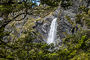 Earland Falls (178 m) on the Routeburn Track in Fiordland National Park, near Te Anau, Southland region, South Island of New Zealand. In 1990, UNESCO honored Te Wahipounamu - South West New Zealand as a World Heritage Area.