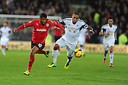 Cardiff city's Fraizer Campbell is challenged by Swansea's Ashley Williams ® . Barclays Premier League match, Cardiff city v Swansea city at the Cardiff city stadium in Cardiff, South Wales on Sunday 3rd Nov 2013. pic by Andrew Orchard, Andrew Orchard sports photography,
