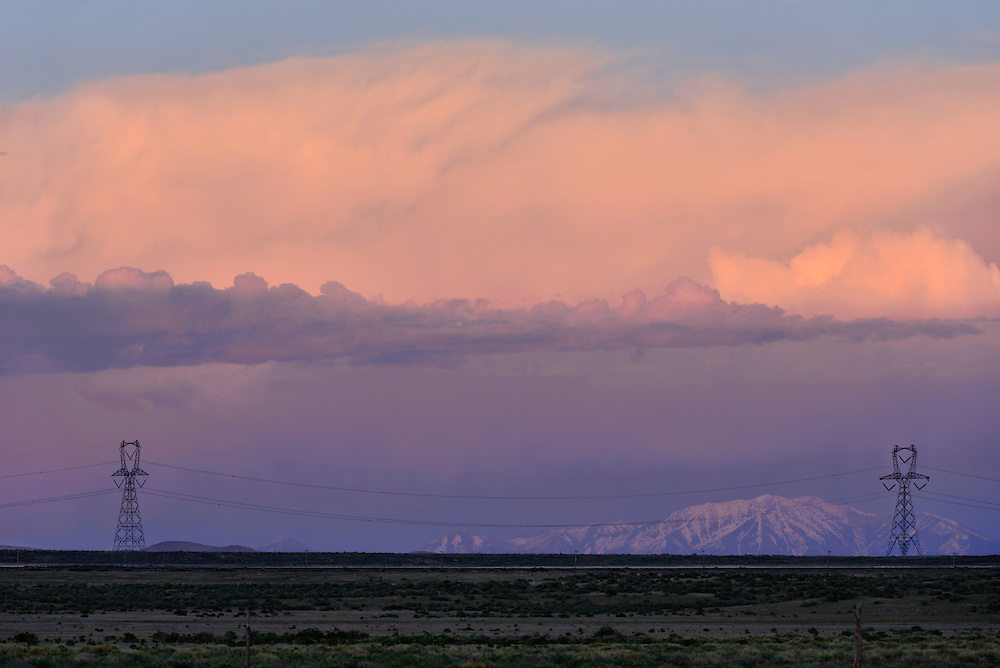 Storm over mountains and power line in the Great Basin desert of Utah.