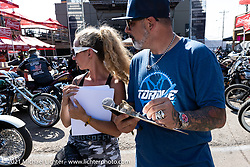 Dennis Kirk Garage Build bike show judges Heather Callen and Jason Hallman at the Iron Horse Saloon during the Sturgis Motorcycle Rally. SD, USA. Tuesday, August 10, 2021. Photography ©2021 Michael Lichter.
