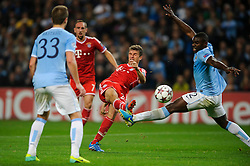 Bayern Midfielder Thomas Muller (GER) shoots as Man City Defender Micah Richards (ENG) challenges during the second half of the match - Photo mandatory by-line: Rogan Thomson/JMP - Tel: Mobile: 07966 386802 - 02/10/2013 - SPORT - FOOTBALL - Etihad Stadium, Manchester - Manchester City v Bayern Munich - UEFA Champions League Group D.