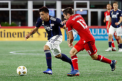 September 22, 2018 - Foxborough, MA, U.S. - FOXBOROUGH, MA - SEPTEMBER 22: New England Revolution forward Guillermo Hauche (22) tries to get past Chicago Fire midfielder Brandt Bronico (13) during a match between the New England Revolution and the Chicago Fire on September 22, 2018, at Gillette Stadium in Foxborough, Massachusetts. The teams played to a 2-2 draw. (Photo by Fred Kfoury III/Icon Sportswire) (Credit Image: © Fred Kfoury Iii/Icon SMI via ZUMA Press)