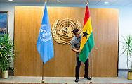 Gavin Pan places the flag of Ghana before President John Dramani Mahama, enters the room.