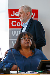 © Licensed to London News Pictures. 31/08/2016. London, UK. Leader of the opposition and Labour leadership candidate JEREMY CORBYN walks past Shadow Health Secretary DIANE ABBOTT before speaking to outline how his policy agenda benefits women on 31 August 2016 at Unison Centre, London. Photo credit: Tolga Akmen/LNP