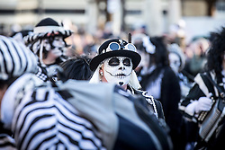 © Licensed to London News Pictures. 16/01/2016. Whittlesey UK.Picture the Pig Dyke Molly dancers at The 37th Straw Bear festival takes place this weekend in Whittlesey. It was the custom to dress one of the confraternity of the plough in straw & call him a Straw Bear, He was made to dance in front of houses & gifts of money or beer & food for later consumption was expected. The present Straw Bear dances through the streets accompanied by his handler & numerous dancers such as Pig Dyke Molly & The Bourne Borderers. Photo credit: Andrew McCaren/LNP