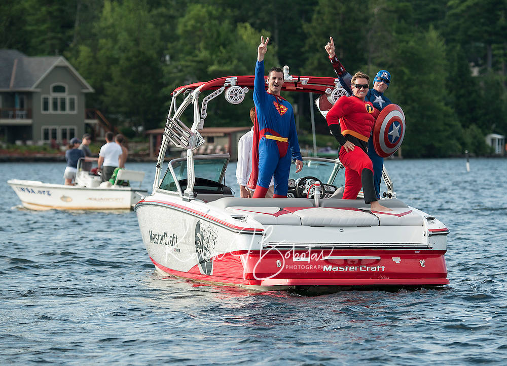 """A Super Hero Mastercraft boat loaded with """"Superman"""" Scott Johnson, """"The Incredible"""" Rick Kelly and """"Captain America"""" Dave Perkins with """"Mr Invisable"""" Jessie Thompson there in spirit for the annual Winni Skiathon held early Saturday morning departing from Winnipesaukee Yacht Club.  (Karen Bobotas/for the Laconia Daily Sun)"""